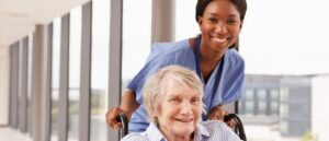 nurse-pushing-woman-wheelchair